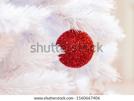 Christmas tree with silver bauble ornaments. Decorated Christmas tree closeup. Balls and illuminated garland with flashlights. New Year baubles macro photo with bokeh. Winter holiday light decoration #1560667406