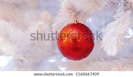 Christmas tree with silver bauble ornaments. Decorated Christmas tree closeup. Balls and illuminated garland with flashlights. New Year baubles macro photo with bokeh. Winter holiday light decoration #1560667409