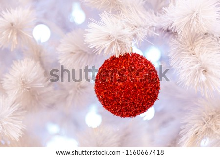Christmas tree with silver bauble ornaments. Decorated Christmas tree closeup. Balls and illuminated garland with flashlights. New Year baubles macro photo with bokeh. Winter holiday light decoration #1560667418