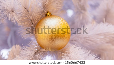 Christmas tree with silver bauble ornaments. Decorated Christmas tree closeup. Balls and illuminated garland with flashlights. New Year baubles macro photo with bokeh. Winter holiday light decoration #1560667433