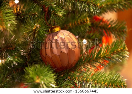 Christmas tree with silver bauble ornaments. Decorated Christmas tree closeup. Balls and illuminated garland with flashlights. New Year baubles macro photo with bokeh. Winter holiday light decoration #1560667445