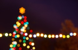 Christmas tree with unfocused bauble in the night