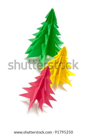 Christmas trees made of paper on white background
