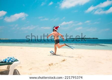 Christmas vacation - man in santa hat on the Maldives tropical beach