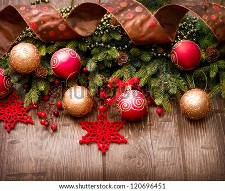 Christmas Vintage Background.Old Styled Border design.Evergreen tree,baubles and ribbon over Wooden Background.Wood