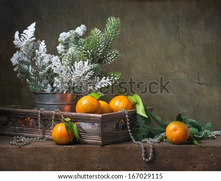Christmas vintage still life with tangerines and  christmas decorations