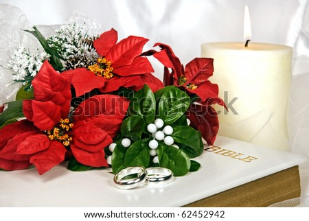 stock photo christmas wedding bouquet and rings on bible