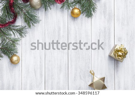 Christmas white wooden background top view. Template for New Year space for text. Mockup for advertising, congratulations. Holiday Greeting Cards Design. Christmas wooden background with fir branches
