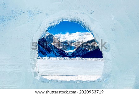 Christmas window to the winter mountains. Winter ice window. Icy window to winter mountains in snow