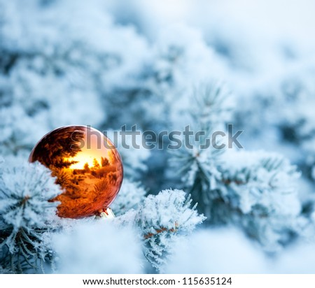 Christmas winter background. Christmas ball on tree