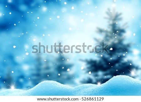 Christmas winter background with snow and blurred bokeh