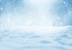 Christmas winter background with snow and blurred bokeh. Happy new year greeting card with copy-space.