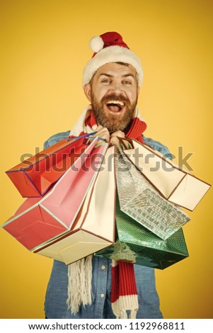 9f30f804ffec8 Black friday sale concept. Christmas winter holidays celebration. Hipster  shopper smile in santa hat and scarf. Black friday
