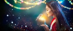 Christmas Winter Woman opening magic Christmas Gift box. Fairy. Beautiful New Year and Christmas scene, Beauty Fashion Model Girl With Present Box at night. Holiday Magic stars and light