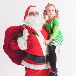 Christmas Wish 2016. Santa Claus and Little Girl. Telling Wishes