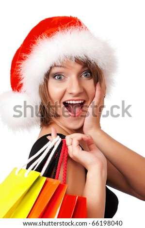 Christmas woman holding shopping bags wearing Santa hat. Isolated on white background.