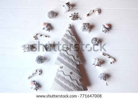 Stock Photo Christmas wooden background with attributes of New Year and Christmas Day. Cute background for card. Merry Christmas and Happy New Year. Minimalism background.