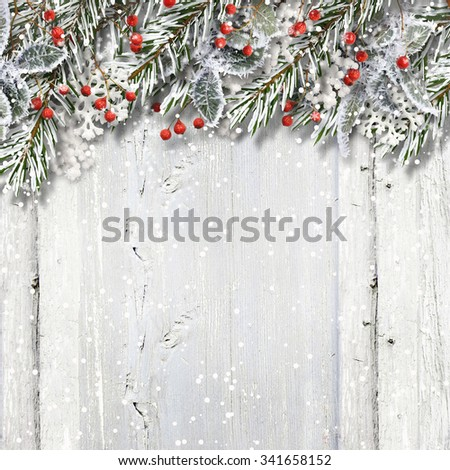 Christmas wooden background with fir branches and holly - Shutterstock ID 341658152