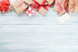 Christmas wooden background with gift boxes. Top view with copy space for your text
