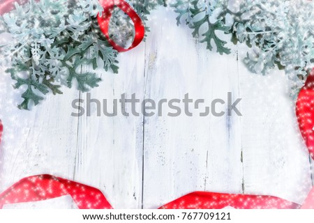 Christmas wooden background with snow branch. Top view with copy space for your text #767709121