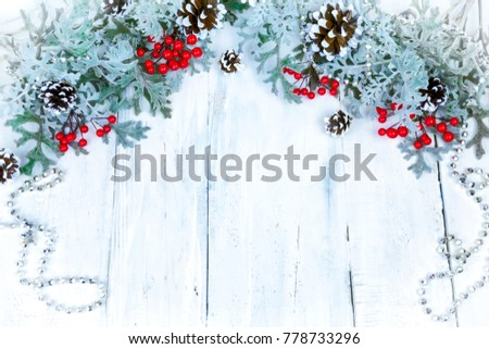 Christmas wooden background with snow branch. Top view with copy space for your text #778733296