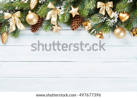Christmas wooden background with snow fir tree and decoration. Top view with copy space for your text #497677396