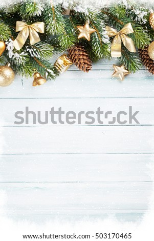 Christmas wooden background with snow fir tree and decoration. Top view with copy space for your text #503170465