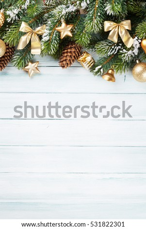 Christmas wooden background with snow fir tree and decoration. Top view with copy space for your text #531822301