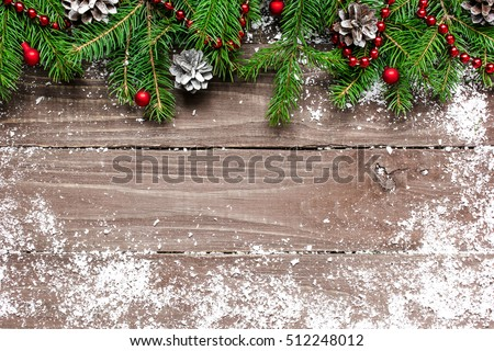 Christmas wooden background with snow fir tree and decorations on wooden background with copy space #512248012