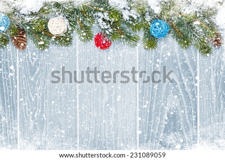 Christmas wooden background with snow fir tree, decor and copy space - Shutterstock ID 231089059