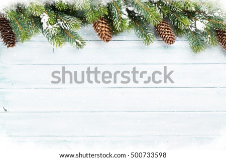 Christmas wooden background with snow fir tree. Top view with copy space for your text #500733598