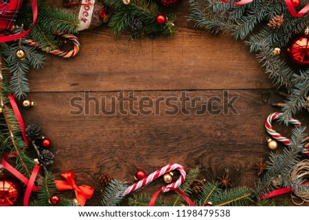 Christmas wooden background with snow fir tree. View with copy space #1198479538