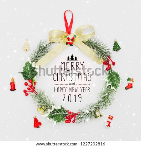 Christmas wreath and Happy New Year 2019 decorative ornament on white background with snow falling.Gifts and congratulations holidays concept. #1227202816