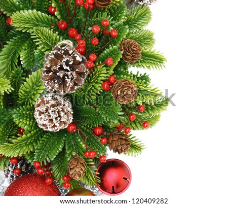 Christmas wreath background with berries, bells and pine cones