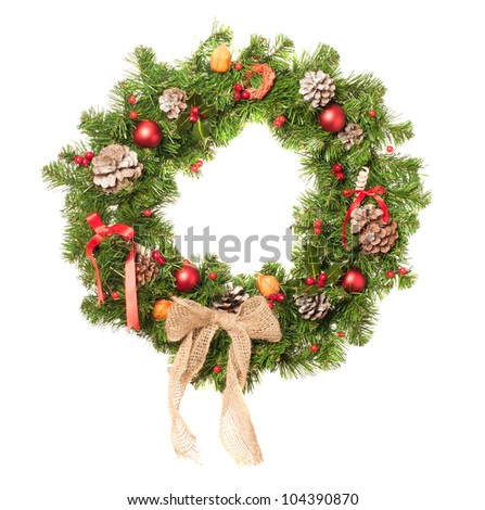Christmas wreath decorated with baubles on a white background - stock photo