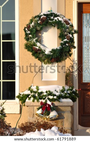 Christmas Wreath, Garland and Bells Covered with Snow