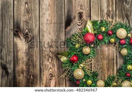 Christmas Wreath Hanging On Rustic Wooden Door Background 482346967