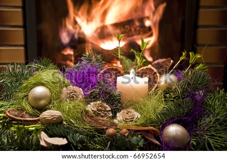 Christmas wreath in front of the fireplace