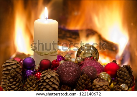 Christmas wreath in front of the fireplace with candels