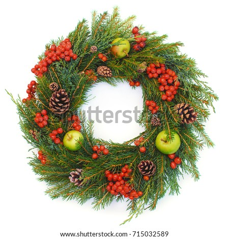 Christmas wreath made of natural materials on a white background.