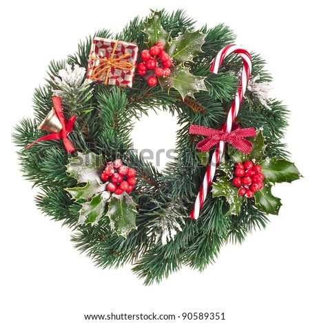 Christmas wreath of nature leaves and berries holly ilex isolated on white