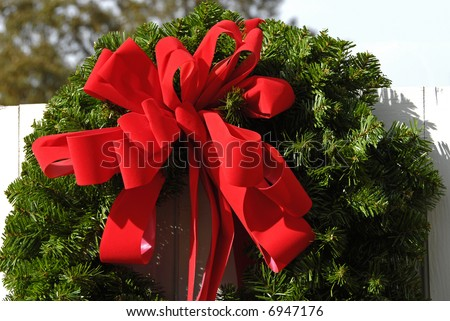 Christmas Wreath on a White Fence