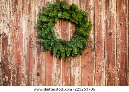 Christmas wreath on the shabby wooden door. Christmas holiday background with copy space