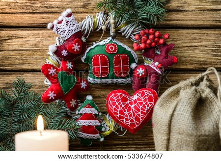 Christmas wreath on wooden background. #533674807