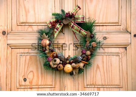 Christmas wreath on wooden door outdoor closeup