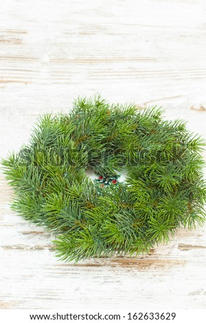 Christmas wreath over old wooden  background. Copy space composition