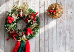 Christmas wreath with a golden pineapple on a wooden board. Copy space