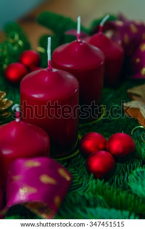 Christmas wreath with candles, decor and ribbons #347451515