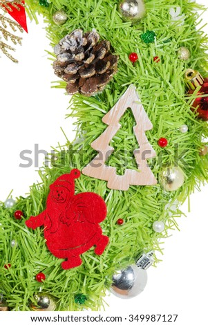 Christmas wreath with decorative Santa Claus (shallow DOF), isolated on white background #349987127