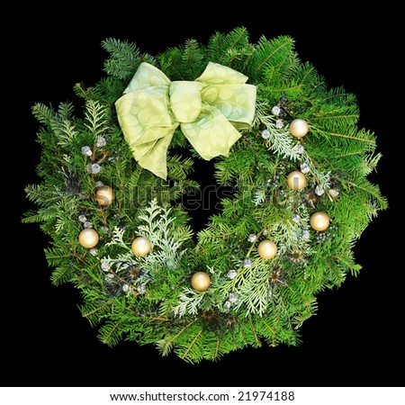Christmas wreath with gold balls and pale green ribbon on dark background - stock photo